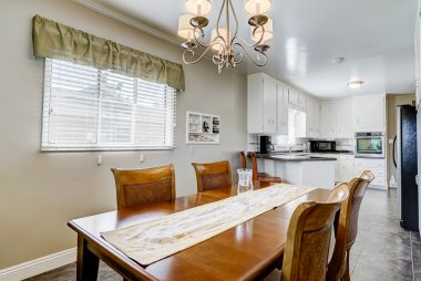 Spacious dining area adjacent to kitchen.