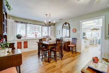 Formal dining room with built-in hutch spacious enough for large family gatherings.