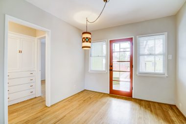 Formal dining room with view into hallway towards the bedrooms.