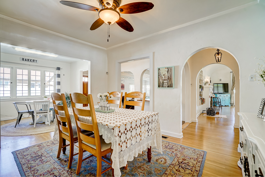Formal dining area with ceiling fan and space for hutch and a really long table for holiday gatherings....with views into the living room and family room.
