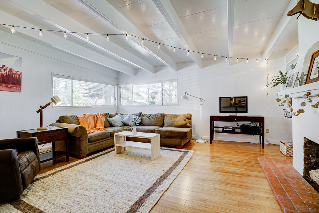 Alternate view of step-down family room with lots of natural light.