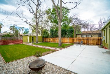 Park-like backyard with auto irrigation, large patio area for entertaining, and newer fencing.