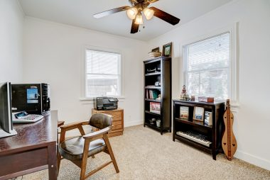 3rd of 3 bedrooms with ceiling fan, 1-yr-old high grade carpet, and walk-in closet!