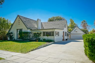 Tudor style with large front picture window and long driveway with detached 2-car garage with 2nd story storage.