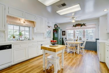 Eat-in kitchen with tiled counter tops, dishwasher, garden window, and space for preparation island.