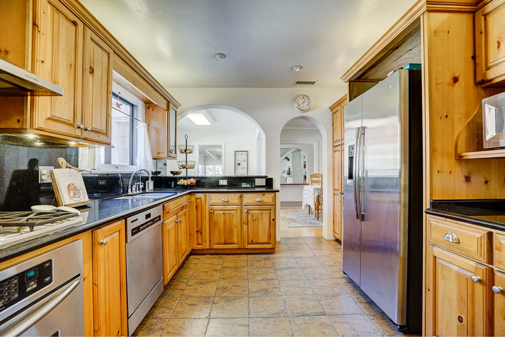 Remodeled gourmet kitchen with view into the casual dining area.