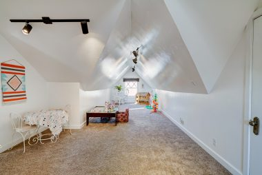 Upstairs loft with plenty of room for gym, play area, or office, with a huge attic area for storage!