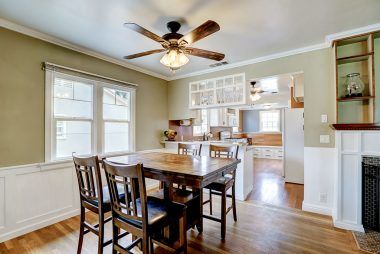 Remodeled kitchen with breakfast bar overlooks the dining room.