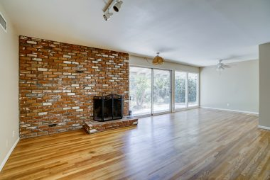 Brick fireplace, refinished hardwood floors, track lighting, ceiling fan over dining area, and all new interior soothing and elegant two-toned paint choices.