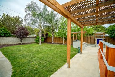 Gorgeous and private back yard with mature trees and patio cover with new deck off the master bedroom suite.
