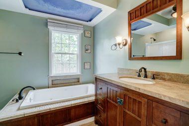 Newer vanity in remodeled hallway bathroom.