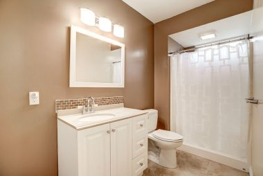 Remodeled private master bathroom with tile flooring.