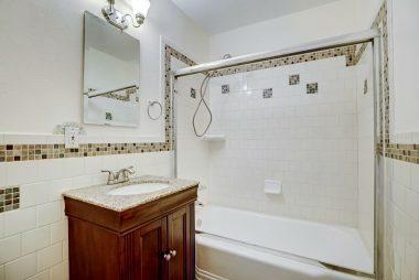 Tastefully remodeled bathroom with subway tile.