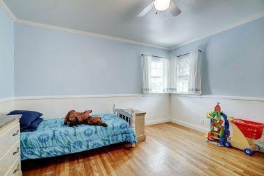 Back bedroom with original oak hardwood floors and lots of natural light.