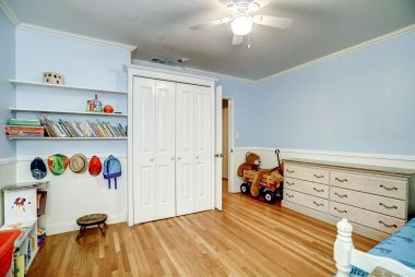 Alternate view of back bedroom with gorgeous oak hardwood floors.