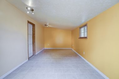 Check out this amazing extra space attached to the garage. Completely drywalled, with electricity and tiled flooring. Use as guest room, office, playroom, or gym....or storage!