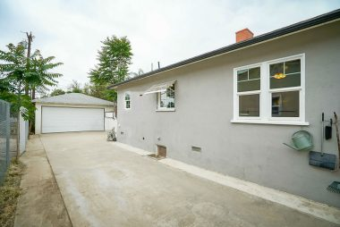 Long gated driveway for RV parking, extra cars, or boat, in addition to a detached 2-car garage with roll-up door.