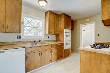 Original but very functional eat-in kitchen with brand new flooring, and newer appliances (dishwasher, double oven, gas range top).