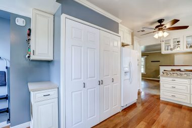 Hidden indoor laundry and custom pet drawers for litter and food.