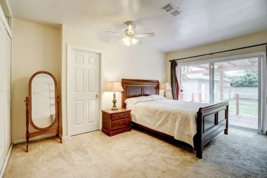 Master bedroom suite with newer dual pane sliding doors to tranquil back yard.