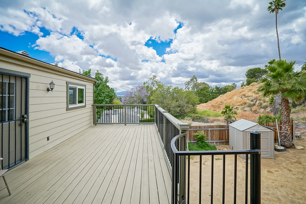 Redwood deck just outside the family room and kitchen with gorgeous Riverside views. The clouds on this day were super fluffy due to a recent rain storm.