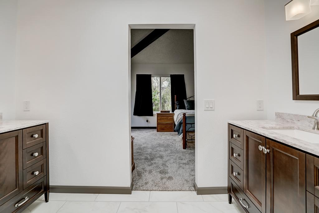 View of both vanities overlooking the master bedroom.