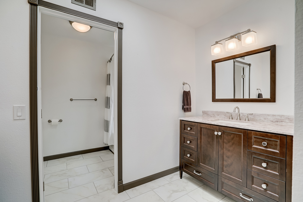 Brand New Remodeled Bathroom With Tile Floor Two Separate Vanities And A Soaking Tub