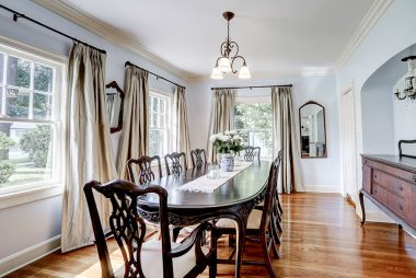 Alternate view of long formal dining room with an alcove for your sideboard or buffet.