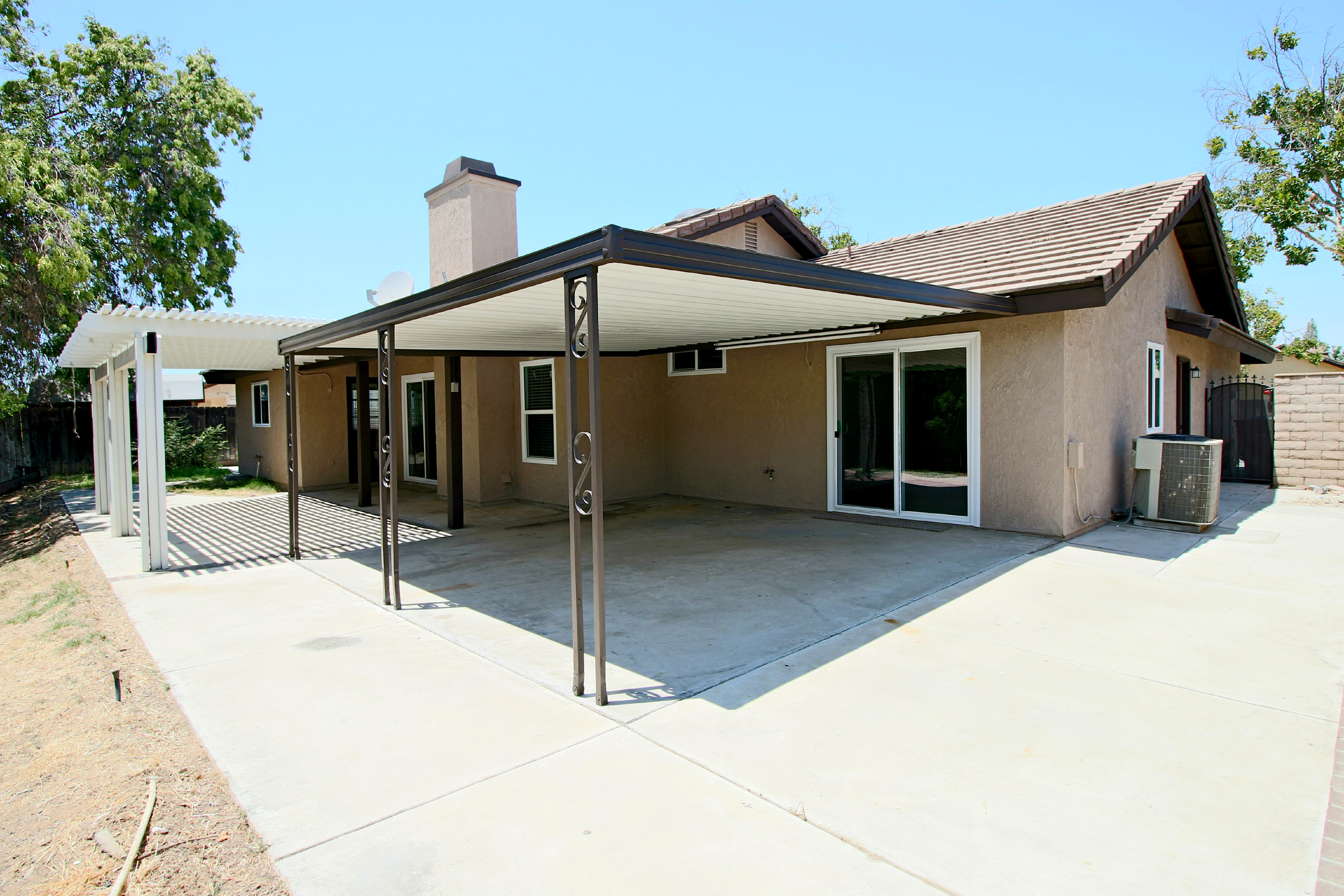 Back Of The House Note Tile Roof Brand New Double Pane Windows And Sliders A Great Covered Patio With Extensive Concrete For Large Family