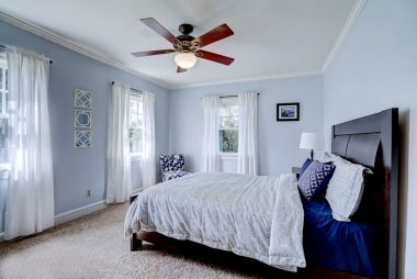 The second of four upstairs bedrooms with new decorator paint, comfy carpeting, and ceiling fan.