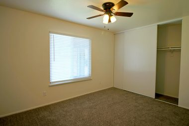 One of four bedrooms (all with new carpet, new paint, new double pane windows, new ceiling fans, and new closet doors).