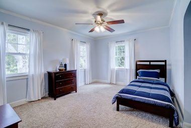 The third of four upstairs bedrooms, with comfy carpeting, new decorator paint, and ceiling fan.