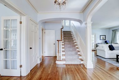 Grand staircase view as you enter the home.