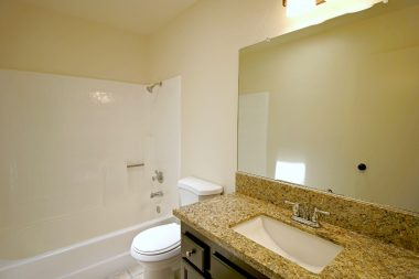 Remodeled hallway bathroom for the 3 bedrooms on one side of the house. Granite counter top on new vanity.