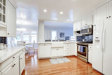 Recently remodeled kitchen with hardwood floors, dishwasher, stainless steel gas stove and built-in microwave, and refrigerator that's included.