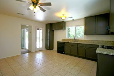 Alternate view of eat-in kitchen to accentuate its size with a French door leading to the back patio.