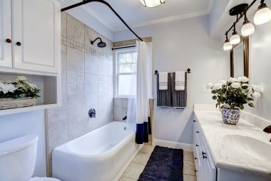Master bathroom with shower in tub, tile floor, and double vanity for the discerning couple.