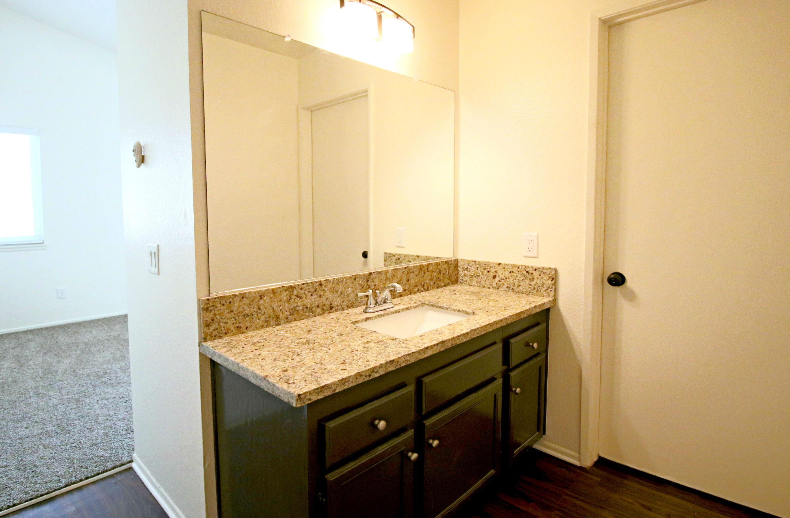 Remodeled Master Suite Bathroom With Granite Counter Top On Brand New  Vanity. New Laminate Flooring