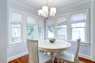 Chic breakfast nook with hardwood floors and lots of natural light. You could reach out the windows to the left and pluck lemons right from the tree!