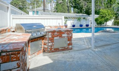 Built-in BBQ area next to the covered patio -- great backyard for entertaining!
