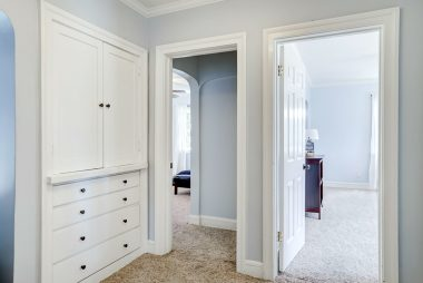 Upstairs landing with spacious linen closet with doorways leading to two more bedrooms