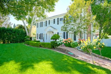 What a stately structure in the heart of the historic Wood Streets neighborhood, with lovely rose trees lining the brick sidewalk, as well as mature shade trees dotting the landscape.