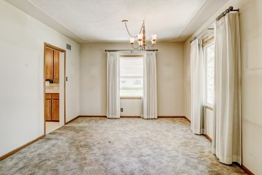Formal dining room (hardwood floors under carpeting).