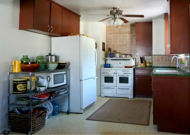 Kitchen with antique stove that is negotiable. Original tile counter tops.
