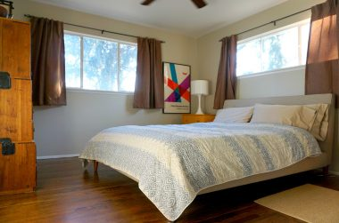 Master bedroom suite with attached private bathroom. Look at those gorgeous hardwood floors.
