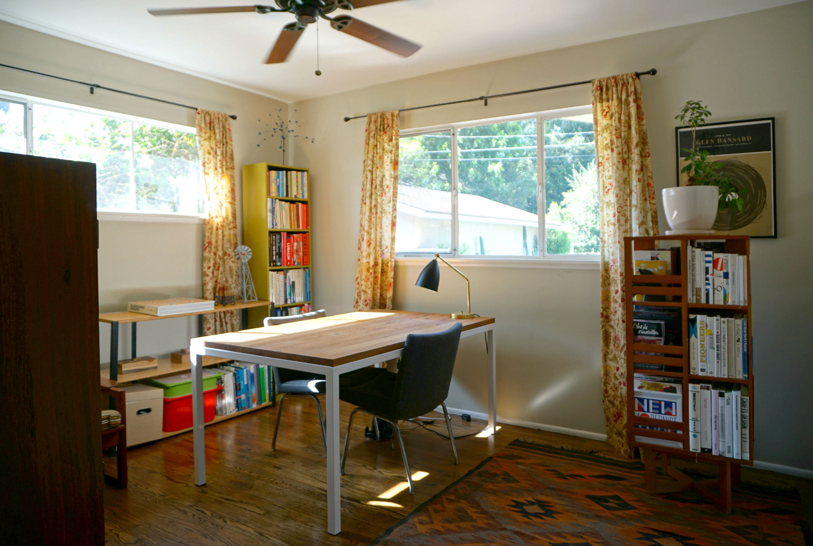 One Of The Three Bedrooms, Being Used As An Office, With Ceiling Fan And
