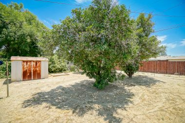 Very large pool-size backyard is a blank slate -- use your imagination and start from scratch to create your dream yard! Alley access for RV or boat parking if needed.
