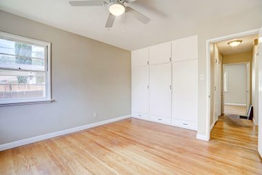 Alternate view of back bedroom with ample closet space and view into hallway.