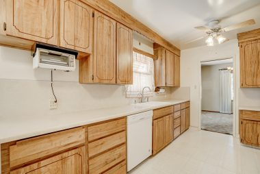 Eat-in kitchen with lots of counter space and cabinetry, as well as a 6-month-old dishwasher.