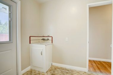 Laundry room with new door to back yard with internal blinds.